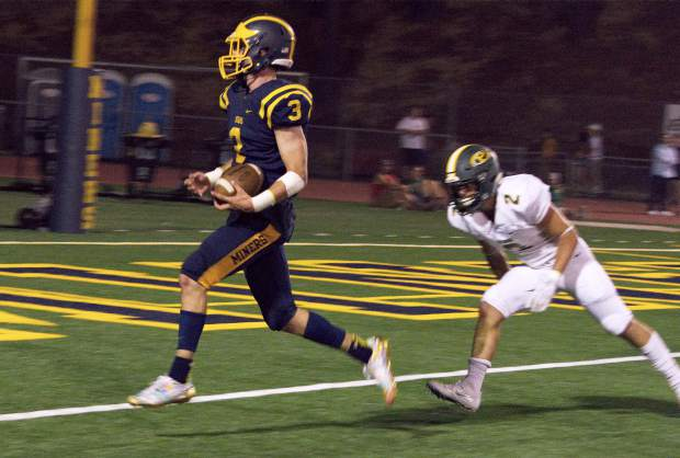 Nevada Union's Dawson Fay scores a touchdown during a game against Placer at Hooper Stadium Friday. The Miners topped the Hillmen, 43-16.