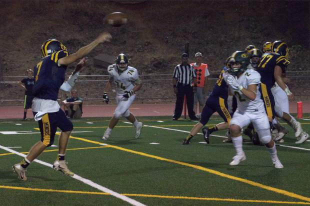 Nevada Union's Owen Dal Bon passes during a game against Placer at Hooper Stadium Friday. The Miners topped the Hillmen, 43-16.