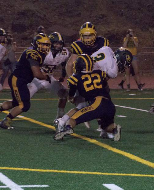 Nevada Union's Jace Wheeler (22) makes a tackle during a game against Placer at Hooper Stadium Friday. The Miners topped the Hillmen, 43-16.