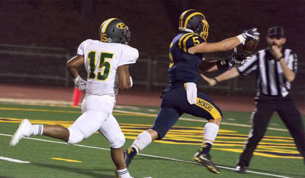 Nevada Union's Tyler Nielson rushes in for a touchdown during a game against Placer at Hooper Stadium Friday. Nielson finished the game with 95 rushing yards to go with a pair of touchdowns and 23 yards receiving.