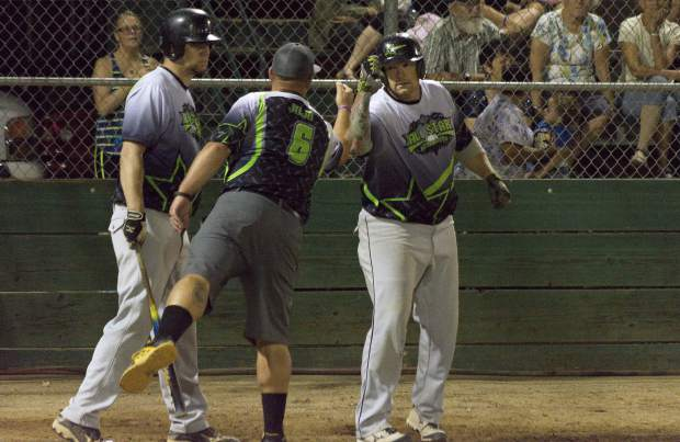 All Star Automotives Justin Nicholson is greeted by a teammate after hitting a solo homerun during the Nevada County Fastpitch Softball American League Championship.