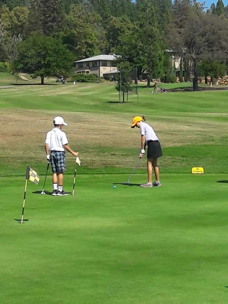 Junior golfers David Ban and Ava Ban practice putting ahead of a Nevada County Junior Golf Tour event at the Nevada County Country Club.