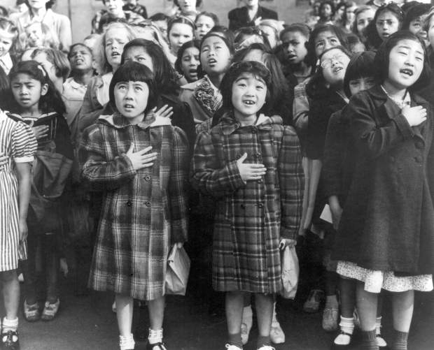 Children at the Weill public school in San Francisco recite the Pledge of Allegiance in April of 1942. Many were evacuees of Japanese ancestry who were later housed in War Relocation Authority centers for the duration of World War II. Roughly 120,000 Japanese immigrants and Japanese-Americans were sent to camps that dotted the West because the government claimed they might plot against the U.S.