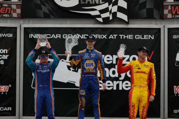 Winner Alexander Rossi, center, poses with second-place finisher, Scott Dixon, left, and third-place finisher, Ryan Hunter-Reay after the IndyCar Series auto race, Sunday, in Watkins Glen, N.Y.