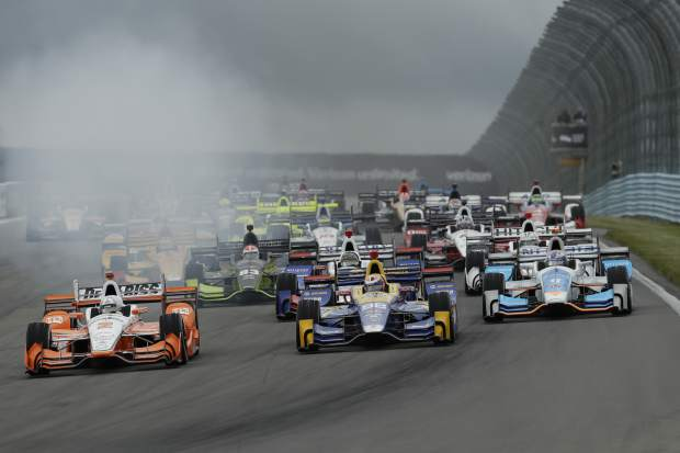 Drives enter Turn 1 during the IndyCar Series auto race, Sunday in Watkins Glen, N.Y.