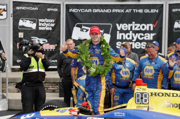 Alexander Rossi celebrates during the IndyCar Series auto race, Sunday in Watkins Glen, N.Y. For Rossi, who won last year's Indianapolis 500 and just inked a contract extension with Andretti Autosport, it is his second career win.