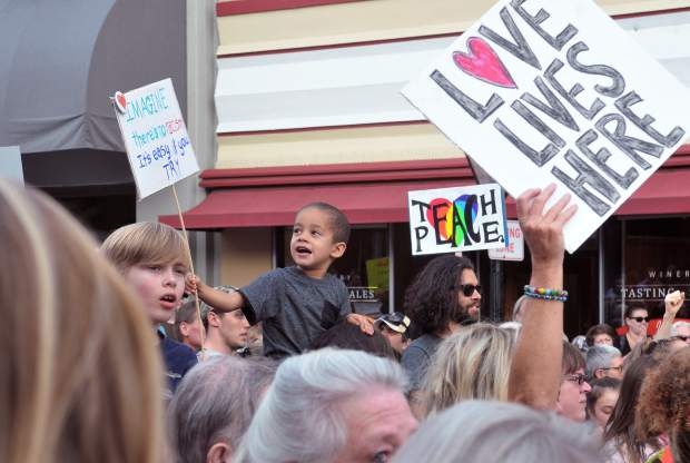 Signs and smiles accompanied those marching for love, peace, and denouncing hate Friday afternoon in downtown Grass Valley.