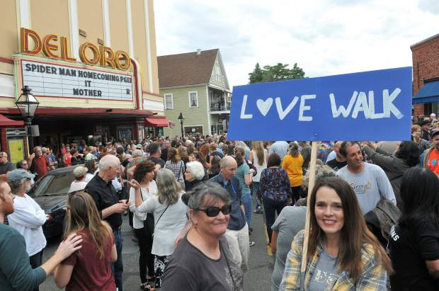 Peaceful protesters hold love walk signs during Friday's march for Imani.