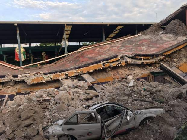 A car sits crushed, engulfed in a pile of rubble from a building felled from a 7.1 earthquake, in Jojutla, Morelos state, Mexico, Tuesday, Sept. 19, 2017. The earthquake stunned central Mexico, killing at least 139 people as buildings collapsed in plumes of dust. (AP Photo/Carlos Rodriguez)