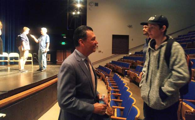 Secretary of State Alex Padilla (center) talks with Nevada Union senior Tyler Gour about what he plans to pursue in his future following high school.