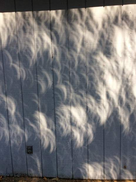 Shadows on the side of a house during the Solar Eclipse Monday.