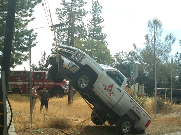 A truck swung wide on a curve headed for a telephone pole Tuesday. Instead of hitting the telephone pole, the truck first straddled the pole's guy wire which lifted it up, taking the driver for a wild ride.