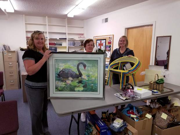 Left to right: Lorraine Larson, Associate Director of Habitat for Humanity, along with volunteers Evelyn Naake and Andria Carlson are cataloguing auction items for their upcoming Street of Dreams fundraiser held on September 29.