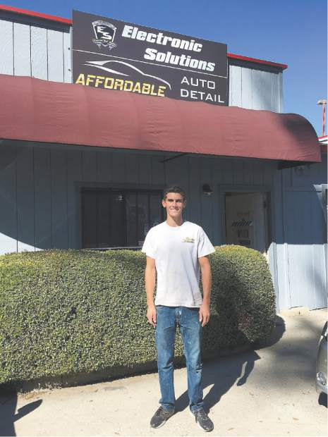 Tyler Sidebottom, owner of Affordable Auto Detail, is happy as can be with his new signs up at his brand new location at 127 Stewart St. in Downtown Grass Valley.