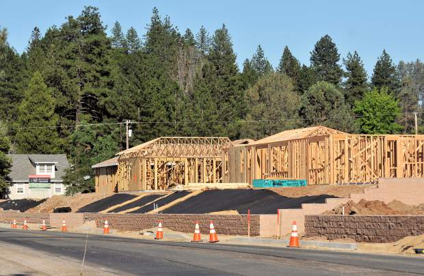 Before: Homes along Ridge Road in Grass Valley are being framed in a photo take in June of 2017.
