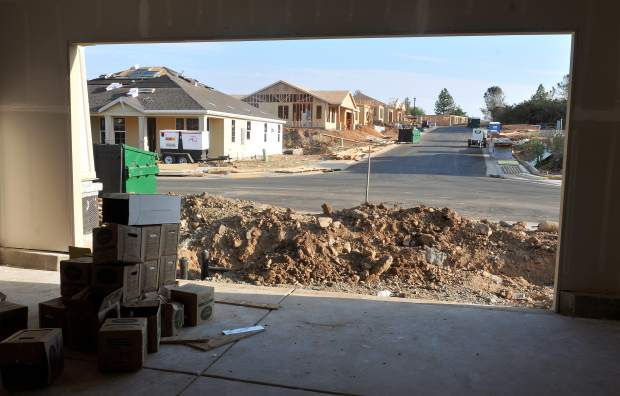 A garage serves as construction storage in the home of a neighborhood being built along Ridge Road in Grass Valley.