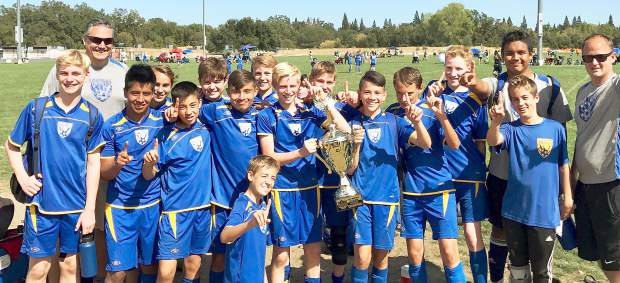At the Roseville Fall Classic, the Gold Country United 2003 Boys team captured the championship with a 3-1 win against the Granite Bay Fire. From left: Toby Ham, asstistant coach Ron Conte, Daniel Velasquez, Banyan Cassidy, Jacob Highsmith, Lorien Fowler, Alex Madrid, Tanner Roberts, Sean Giomi, Jake Slade, Zachary Fairchild, Bryce Nguyen, Nino Conte, Conner Trujillo, Mario Lopez, Nathan Wilson and coach Tim Highsmith (not pictured, Zach Philips and Kahilil Roda).