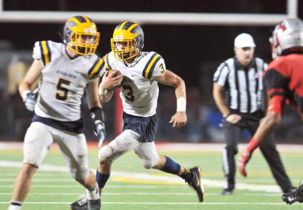 Nevada Union's Dawson Fay (3) runs the ball while Tyler Nielson (5) leads the way during a game against Antelope last week. The Miners are set to host Placer tonight in their home opener.