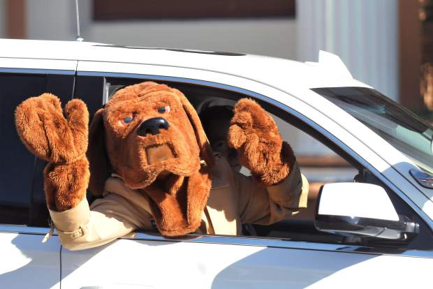 McGruff the Crime Dog waves to folks along Mill Street as the safe trick or treat event came to a close.