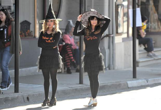 A pair of witches of La Te Da, walk the streets of downtown Grass Valley during Tuesday's safe trick or treat event.