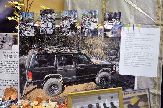 A photo at Derek Sorensen's altar shows his old jeep that was somehow spared from the Lobo Fire through everything else around it burned.