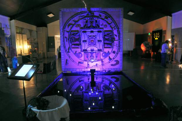 The Changing Earth Mandala by Don Baldwin rotates through different colors behind a meditation pool. The altar honors all who have given their lives to protect their land, forests, waters, and minerals and is on display among 50 others at the Nevada County Fairgrounds through Nov. 5.