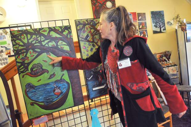 Mixed media painter and sculptor Valerie Messervy Birkhoff explains one of her paintings that uses public input to create.
