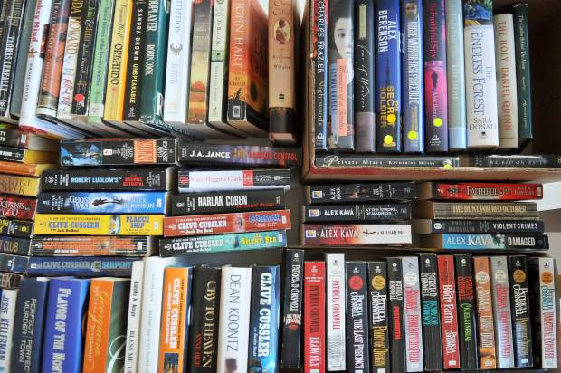 Thousands of books ranging from comedy, history, fiction, non-fiction, and celebrity biographies, sit on display tables in the Eric Rood Center for the county's annual book sale. The book sale will go on through Oct. 27.