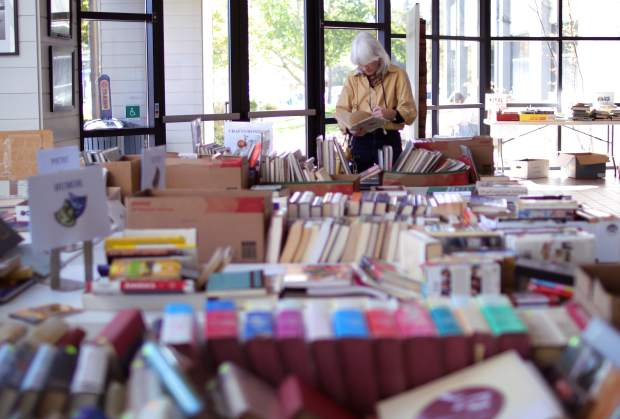 Nevada City's Laura Jane Coats gets lost in a sea of books available for sale during the county's book sale to benefit the United Way of Nevada County.