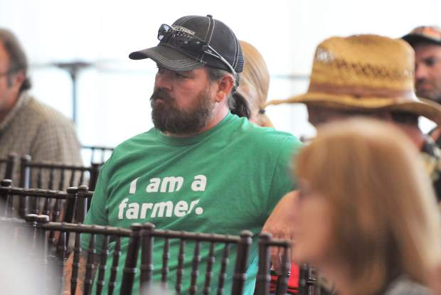 Local cannabis farmer Charles Hamilton shows support while informing himself along with other members of the public during Tuesday's community advisory group on cannabis.