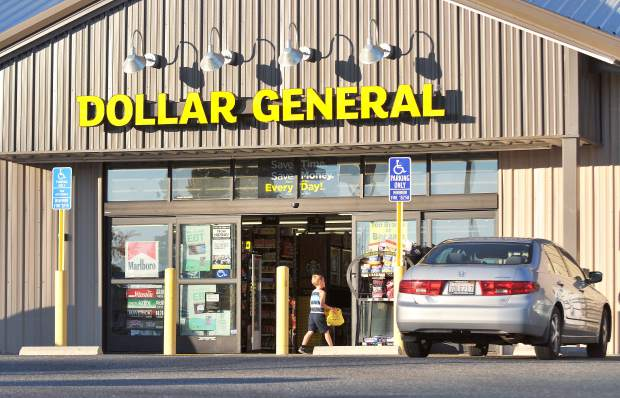 A young shopper enters the Dollar General store in Grass Valley Thursday evening while Nevada County Planning Commissioners discuss the fate of three proposed Dollar Generals for Penn Valley, Alta Sierra, and Rough and Ready.