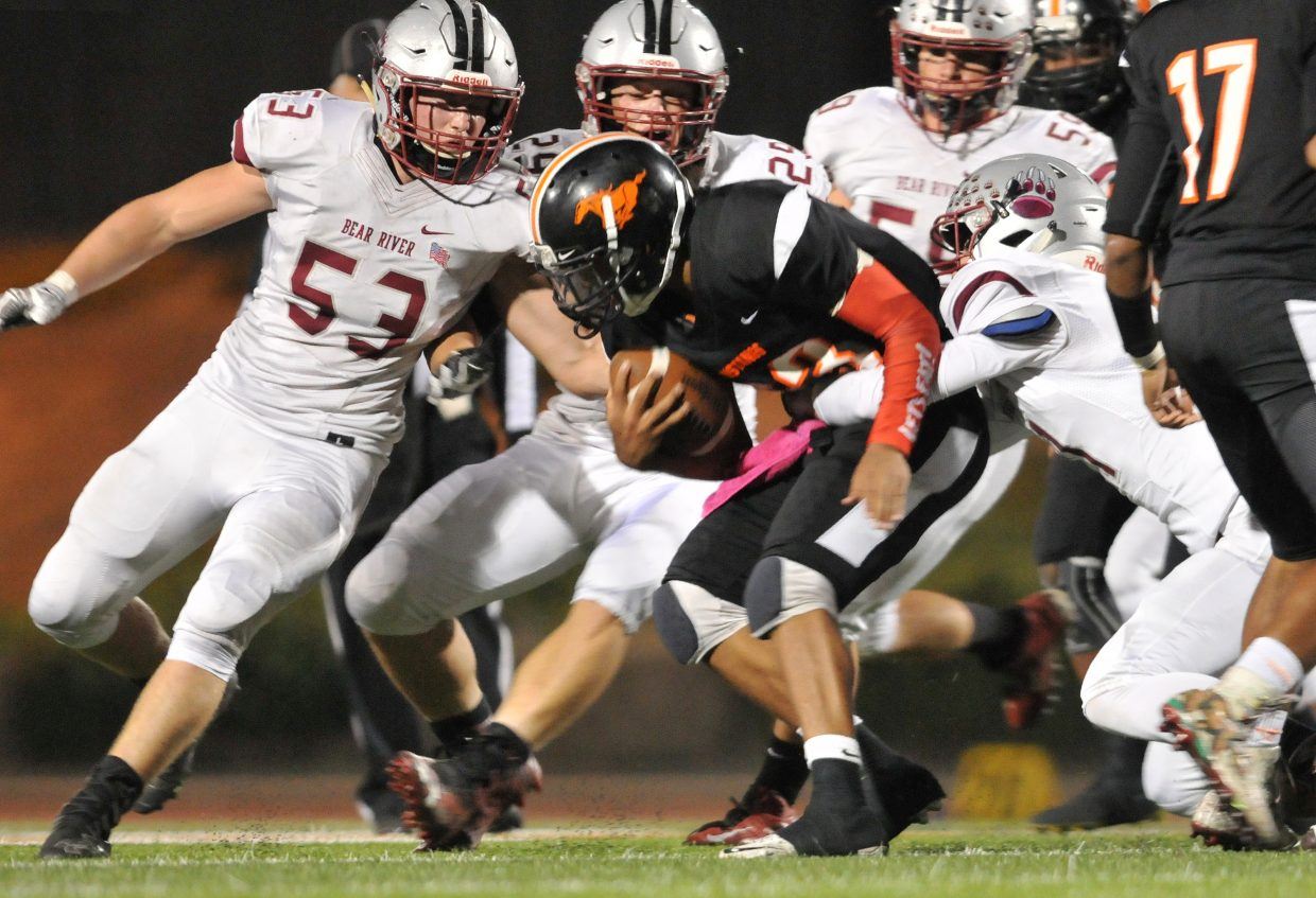 Bear River defenders pull down a Foothill ball carrier.