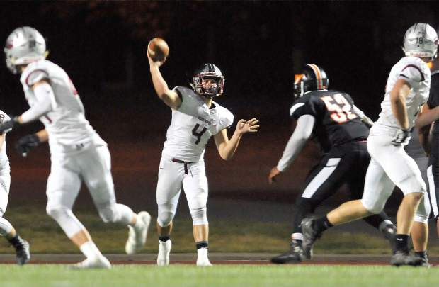 Bear River quarterback Luke Bagget readies to fire a pass to a receiver during Friday night's win over the Foothill Mustangs.