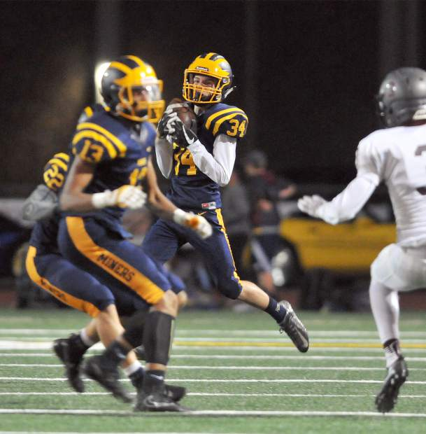Nevada Union's A.J. Meyer (34) hauls in a kickoff from the Woodcreek Timberwolves during Friday's homecoming game.