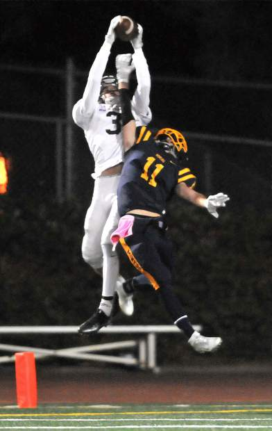 Nevada Union's Will Smith (11) can't keep Woodcreek's Brendan Covello (3) from pulling down this endzone pass during Nevada Union's 54-53 loss to the Timberwolves.