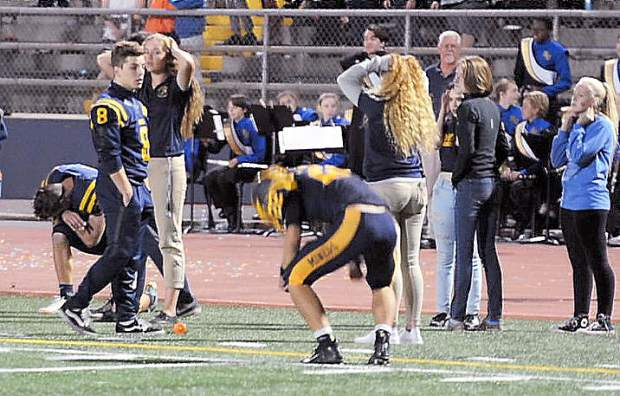 The Miners sideline becomes somber after their heartbreaking last second loss to the Woodcreek Timberwolves.