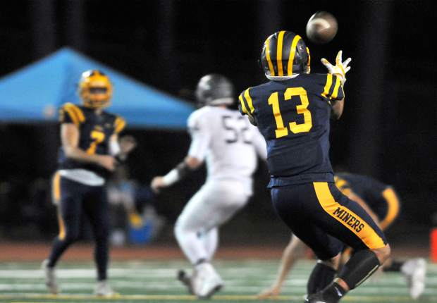 Nevada Union's Cameron Dallago (13) readies to catch a pass from quarterback Owen Dal Bon during the Miners' 54-53 loss to the Woodcreek Timberwolves.