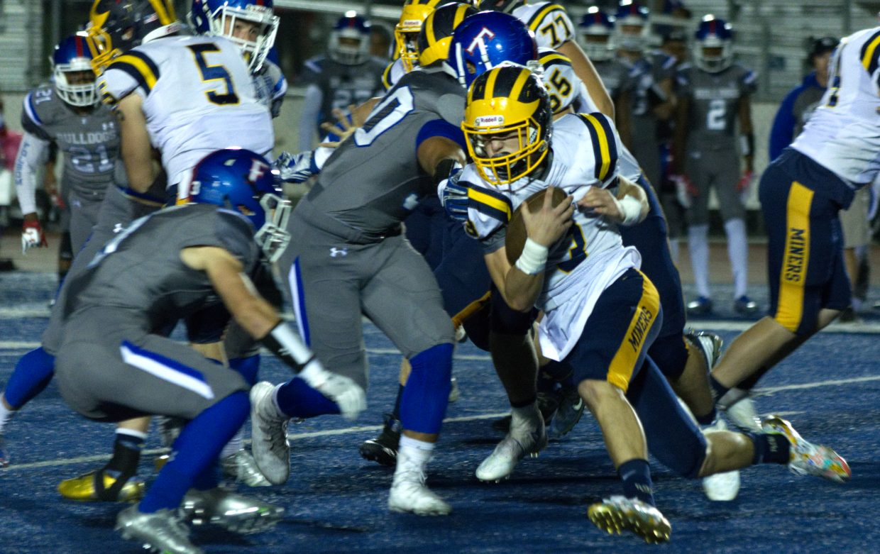 Nevada Union's Dawson Fay looks for some room to run during a game against Folsom.