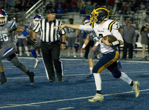 Nevada Union's Owen Dal Bon runs with the ball during a game against Folsom Friday night.