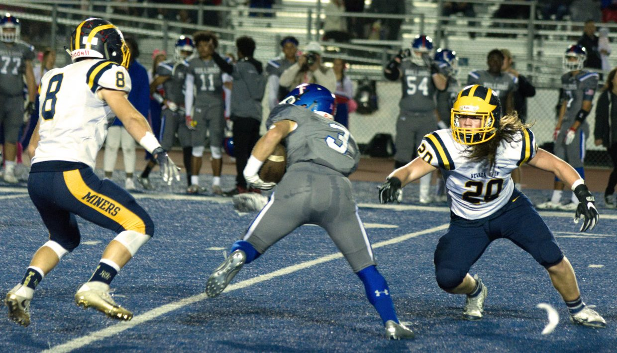 Nevada Union defenders try to tackle a Folsom receiver.