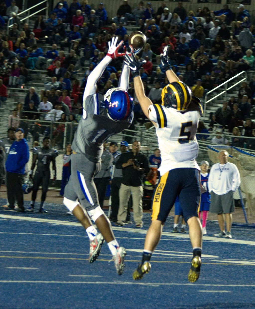 Nevada Union's Tyler Nielson battles for a pass during a game against Folsom. The pass would fall incomplete.