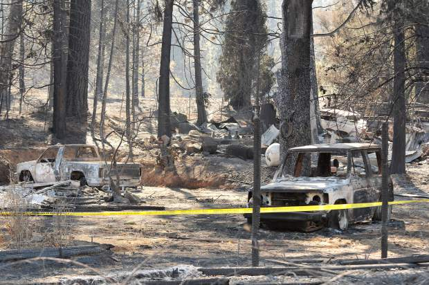 The charred skeletons of vehicles on this McCourtney Road property are the only way to identify where a home once stood.