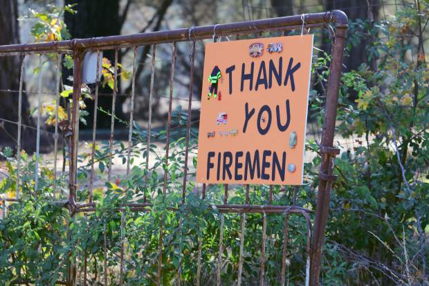 Signs along roads up and down the county, including this one off of McCourtney Road, thank firefighters for fighting to save their homes and property