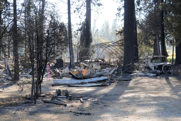 Remnants of property sit charred off of McCourtney Road a little more than a week after the McCourtney Fire scorched 76 acres. The McCourtney Fire was 100 percent contained on Saturday October 14.