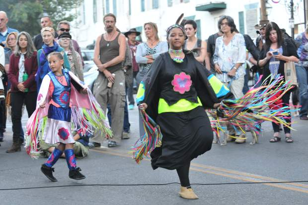 Fancy dress dancers from the Pit River Indians perform during Friday night's ceremony in the streets of downtown Nevada City.