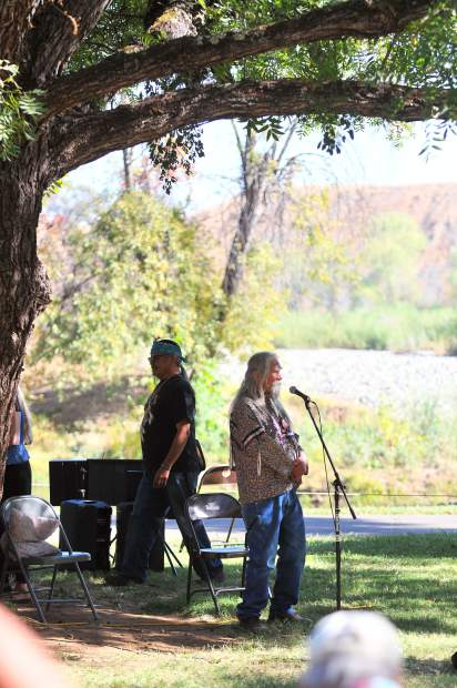 Fred 'Coyote' Downey prepares to sing a song while under the trees of Kulu, or Sycamore Ranch off of Highway 20 near Browns Valley where much of this years' Indigenous Peoples Days celebrations occurred.