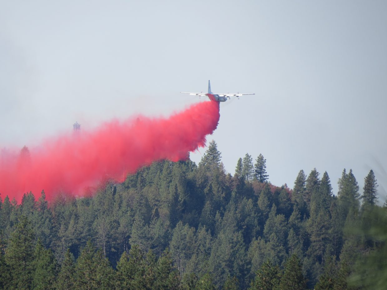 Retardant being dropped on the Lobo Fire this morning.