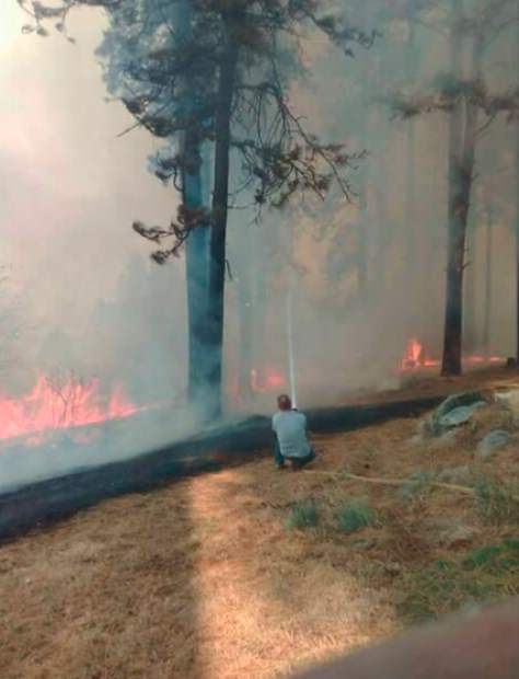 A custodian fending off flames that threatened Nevada City School of the Arts.