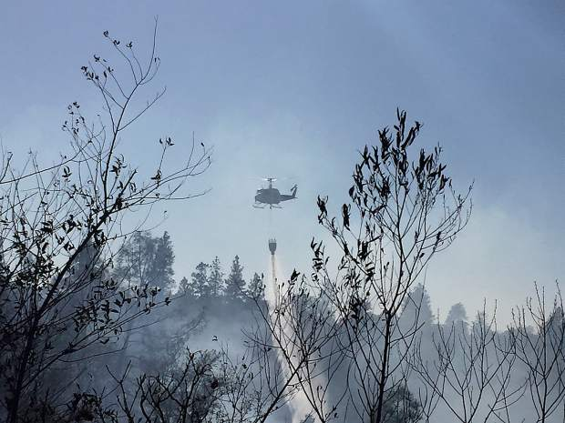 Helicopter dumping water on Lobo fire near Rough and Ready.