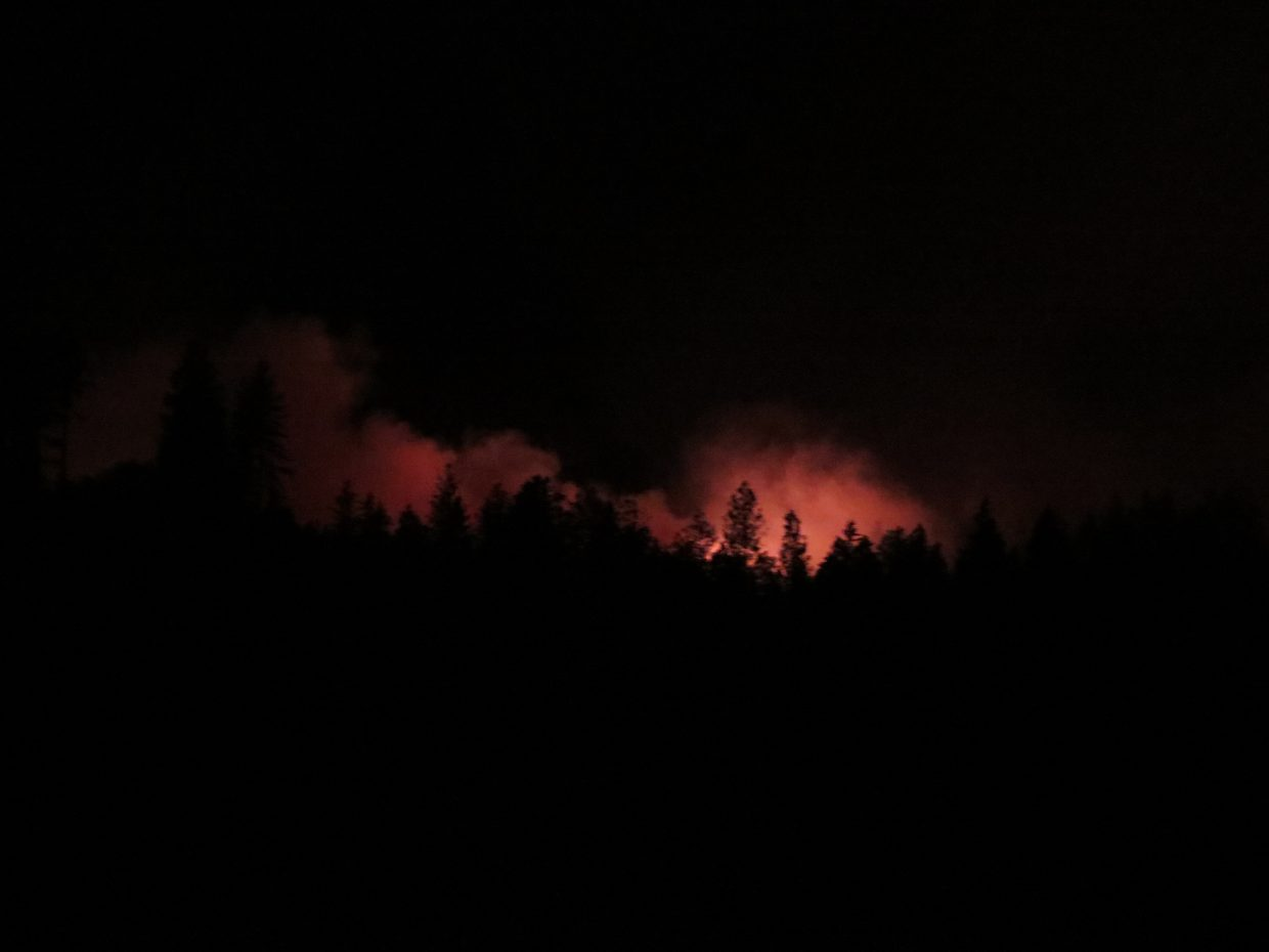 Shot of the Lobo fire glowing in the darkness in the early morning.